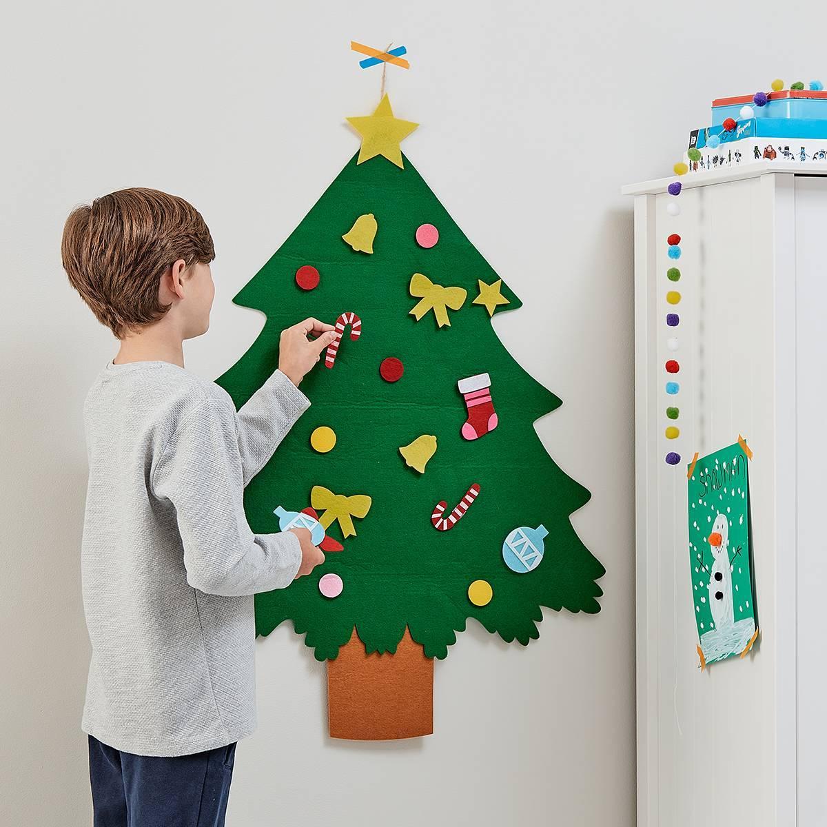 child decorating felt tree