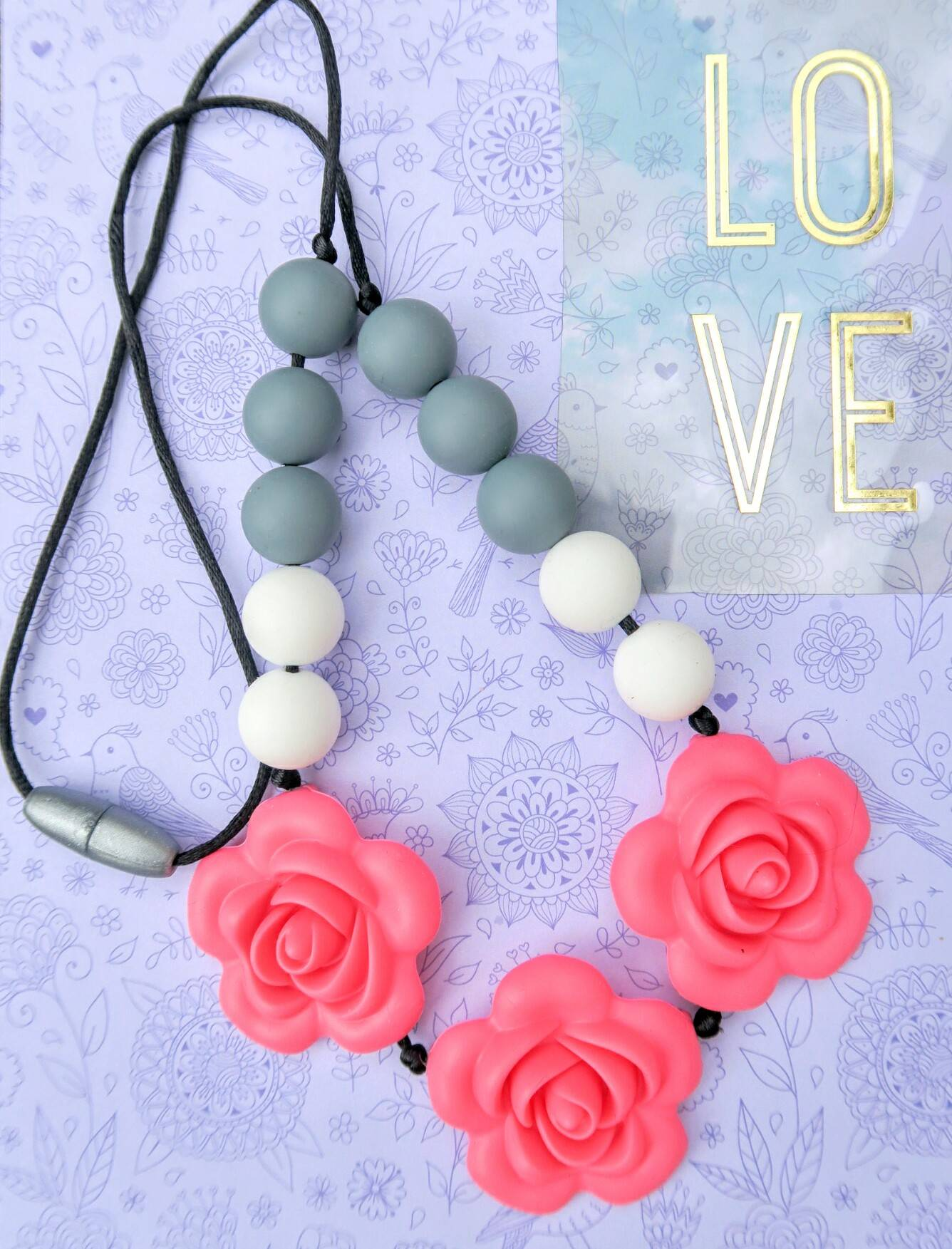 These gorgeous necklaces are actually teething necklaces, safe for Baby to chew on.