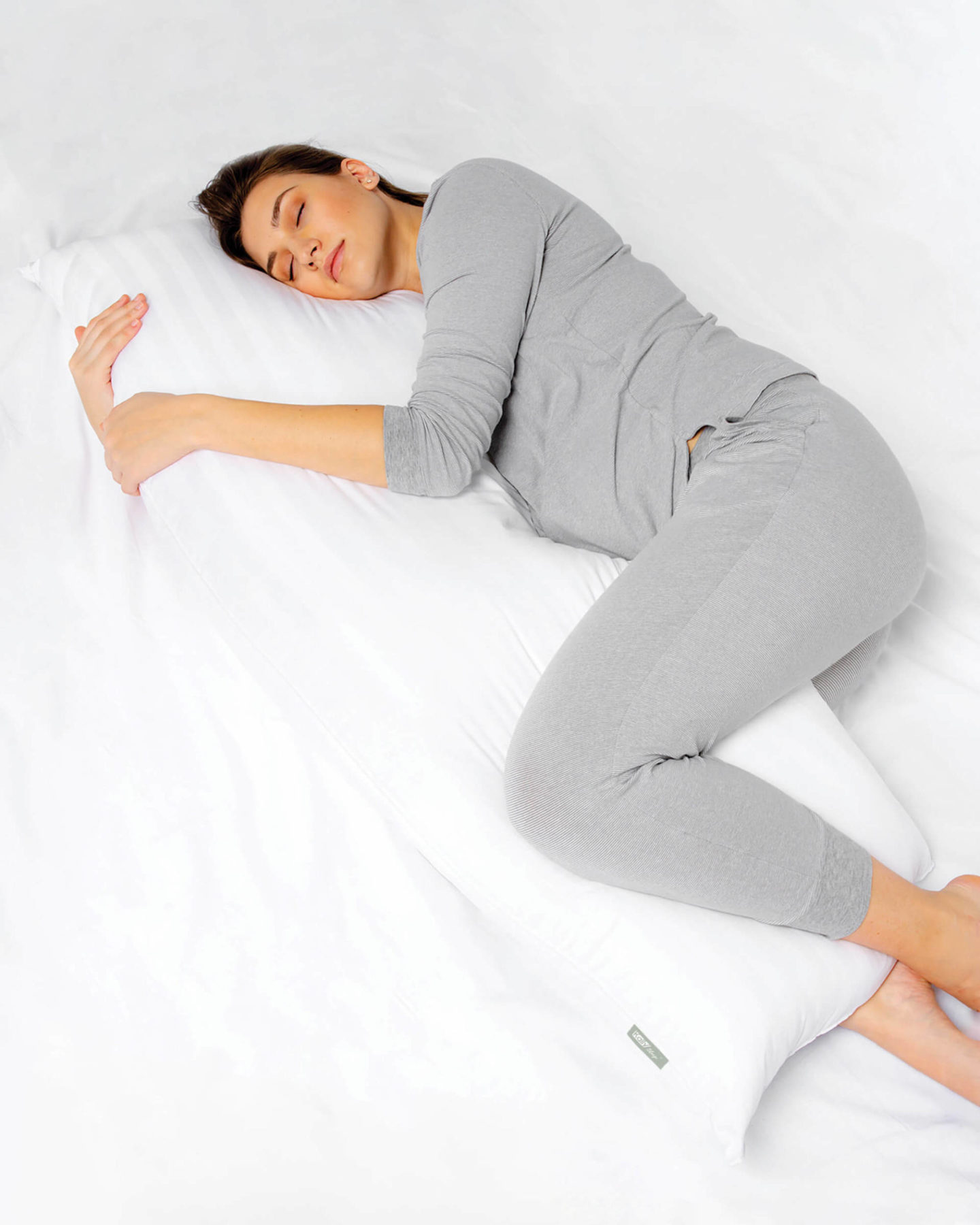 pregnant woman sleeping with bolster support pillow from kally sleep