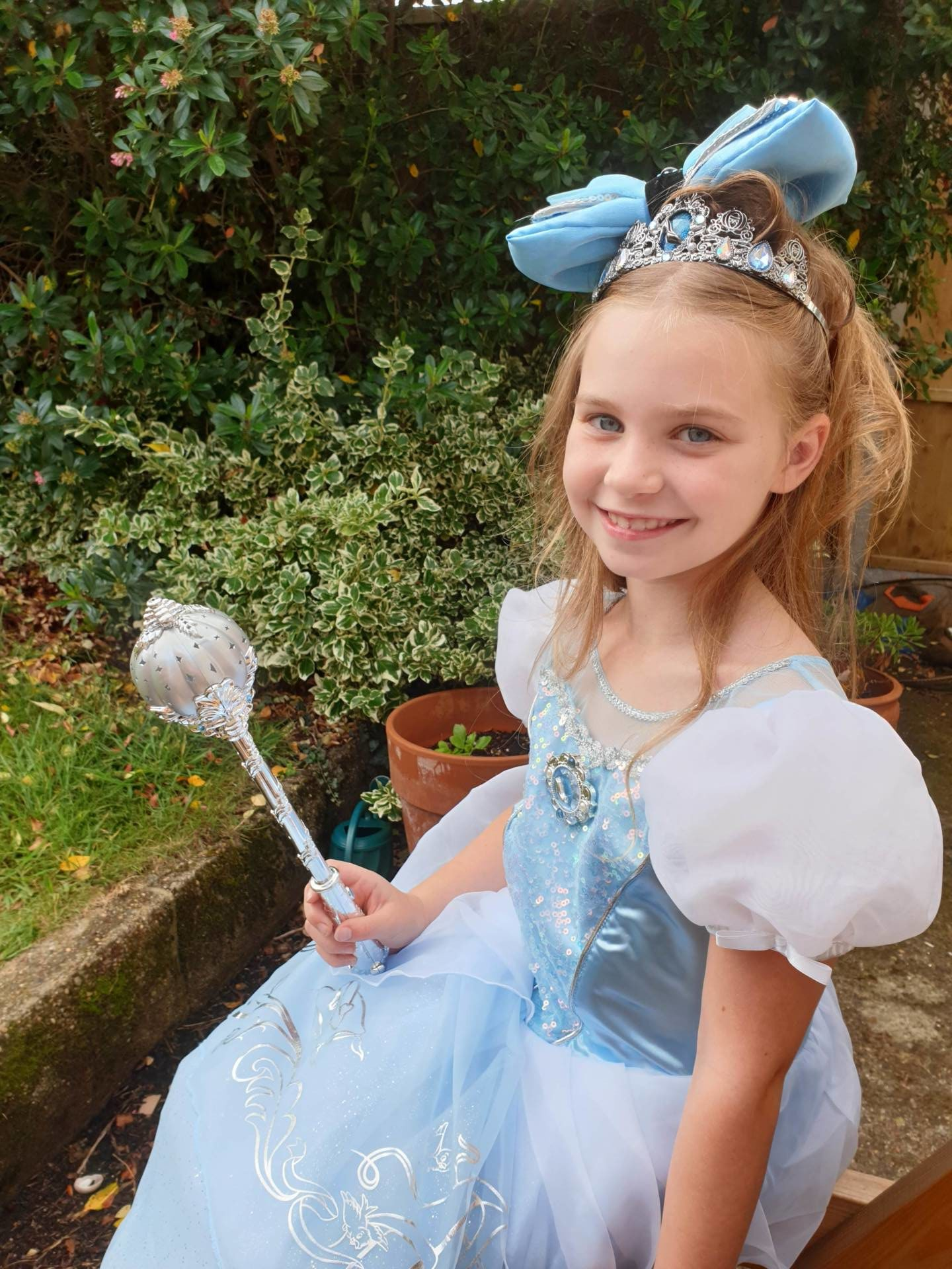 little girl modelling cinderella dress and accessories