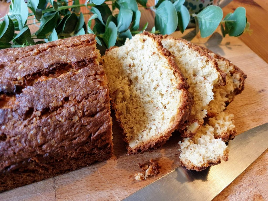 Banana bread on board with knife