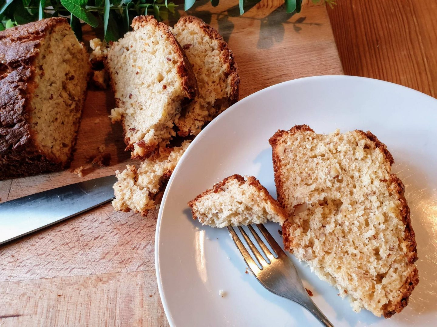 banana bread on white plate with fork