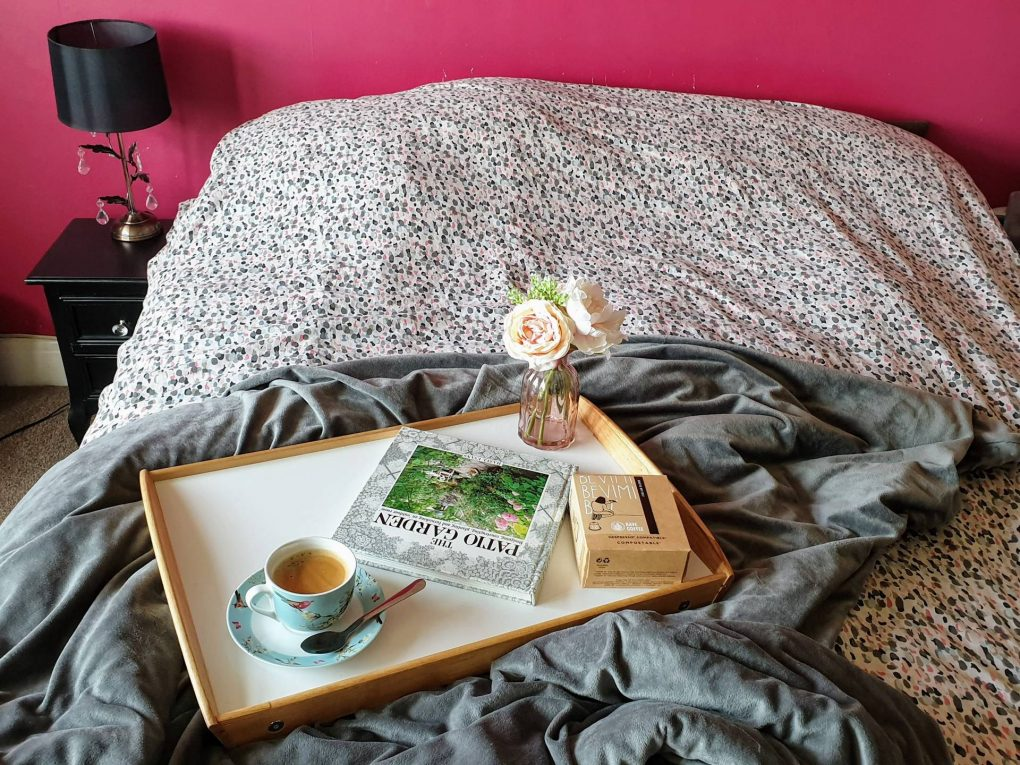 coffee pod and cup on tray in bedroom