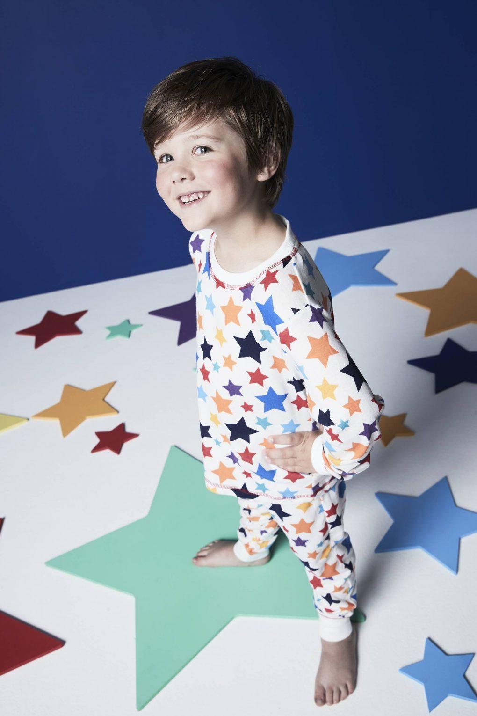 boy in star pyjamas